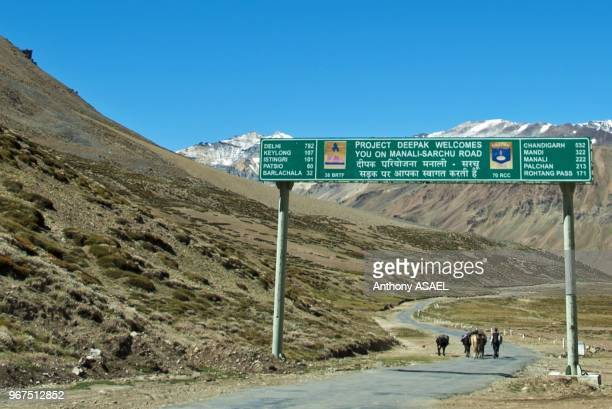 India Ladakh scenic landscape with man walking on the road in the Himalayas