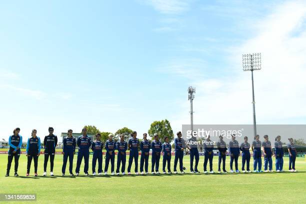 India line up for the national anthem during game one of the Women's One Day International series between Australia and India at Great Barrier Reef...