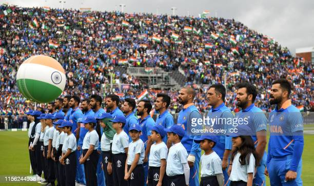 India line up for their national anthem ahead of the Group Stage match of the ICC Cricket World Cup 2019 between Pakistan and India at Old Trafford...