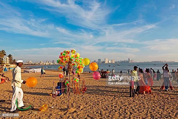 India Maharashtra Mumbai Balloon and toy windmill seller on Chowpatty Beach