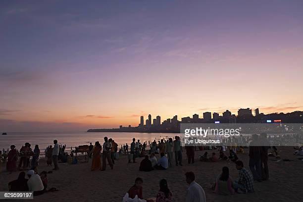 India Maharashtra Mumbai Crowd on Chowpatty Beach at dusk