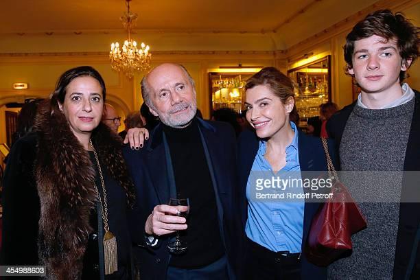 India Mahdavi her son Miles Mahdavi journalist Erik Emptaz and Daphne Roulier attend the FrançoisXavier Demaison show 'Demaison S'Evade' Premiere at...