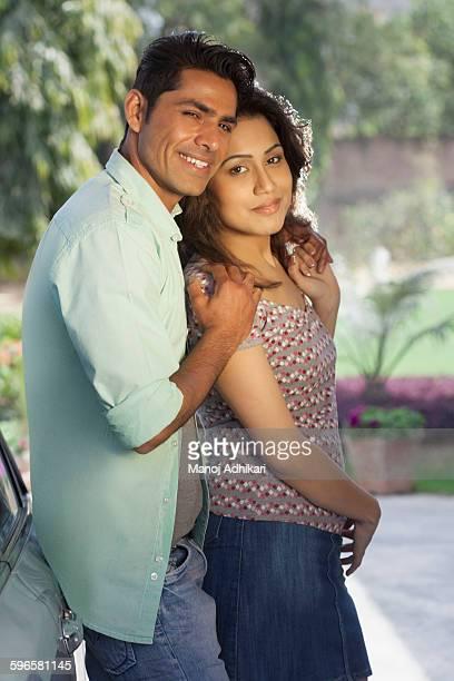 India, Man and woman hugging on backyard
