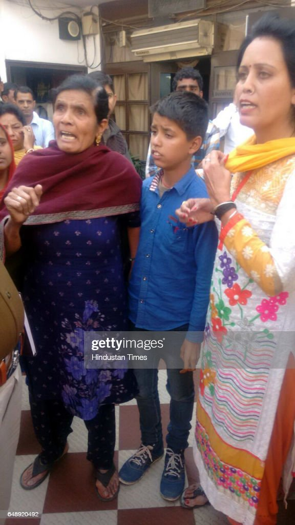 People looking at the woman claiming first wife of the groom Vishal Kumar Sonu thrashing him outside the marriage venue on March 4 in Ludhiana