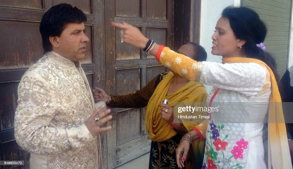 Woman claiming first wife of the groom Vishal Kumar Sonu thrashing him outside the marriage venue on March 4 in Ludhiana India