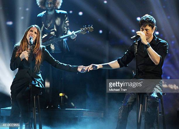 India Martinez and Enrique Iglesias peform onstage during the 14th Annual Latin GRAMMY Awards held at Mandalay Bay Resort and Casino on November 21...
