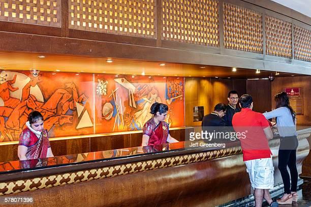 India Mumbai Apollo Bandar Colaba The Taj Mahal Palace hotel inside lobby front desk reception check in woman staff guest wearing sari