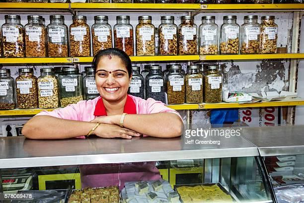 India Mumbai Churchgate Suryodaya grocery store supermarket counter dried fruit display sale Hindu woman employee job smiling
