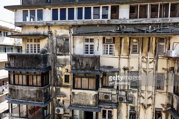 India Mumbai Churchgate Veer Nariman Road apartment building residences exterior dirty mold mildew soot