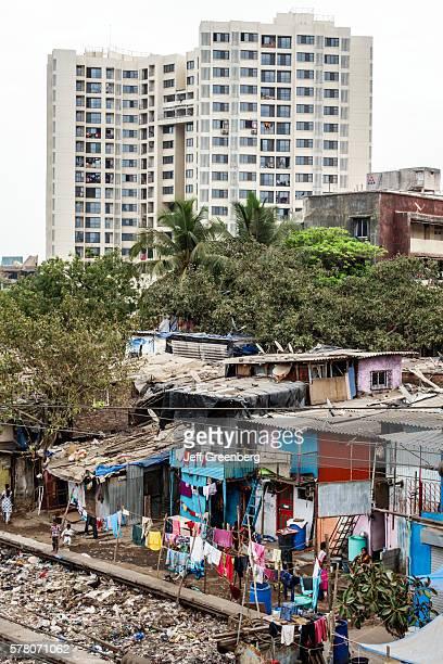India Mumbai Dharavi Shahu Nagar slum shanties high population density poverty residents low income poor high rise apartment building modern