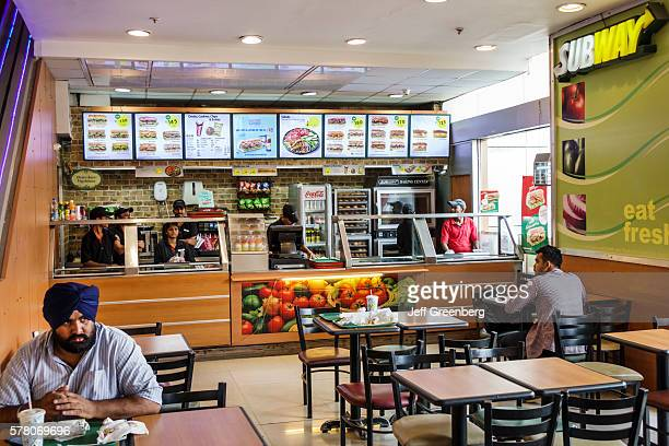 India Mumbai Lower Parel High Street Phoenix mall Subway sandwich shop subs sandwiches man turban Sikh dastar wearing inside restaurant overhead menu...