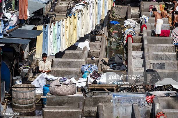 India Mumbai Mahalaxmi Dhobi Ghat Dhobighat hanging laundry open air Laundromat outdoor man working