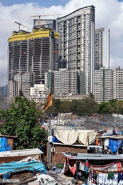 India Mumbai Mahalaxmi Dhobi Ghat Dhobighat hanging laundry open air Laundromat outdoor high rise modern condominium apartment building construction