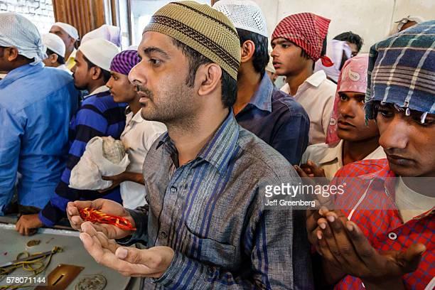 India Mumbai Worli Haji Ali Dargah mosque Indo-Islamic Architecture Sayyed Peer Haji Ali Shah Bukhari tomb separate praying room man men's taqiyah...