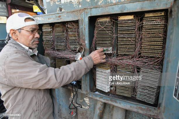 india new delhi an electrician working on a fuse box in chandni chowk in  the old