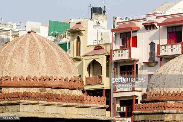 India New Delhi Hauz Khas complex dating back to 13th century Dome and homes apartment blocks behind Islamic architecture