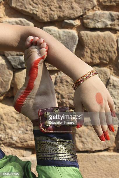 India New Delhi Lodhi Gardens Indian teenager practicing Bharat Natyam traditional classical dance wearing a sari and traditional jewelry Detail of...