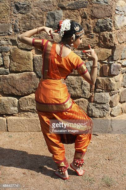 India New Delhi Lodhi Gardens Indian teenagers practicing Bharat Natyam traditional classical dance wearing a sari and traditional jewelry