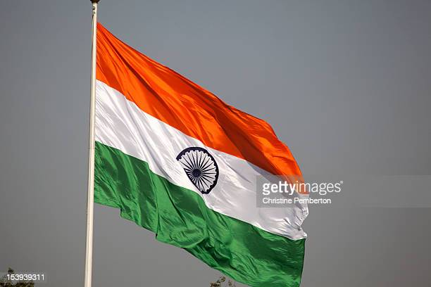 india. new delhi. national flag flying from flagpole - indian flag stock pictures, royalty-free photos & images