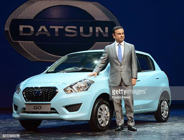 GURGAON India Nissan Motor Co CEO Carlos Ghosn stands by a Datsun brand car premiered in Gurgaon India on July 15 2013 Nissan is reviving the...
