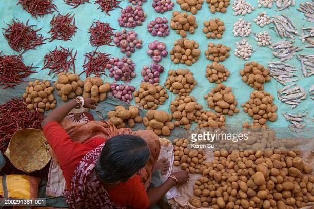 India, Orissa, hill tribeswoman at local market, overhead view