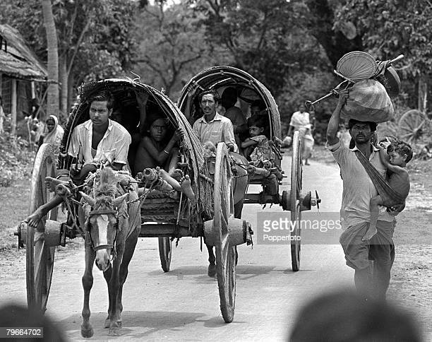India Pakistan Civil War 22nd June 1971 A refugee carries his baby at his side and his worldly possessions on his head as he approaches West Bengal...