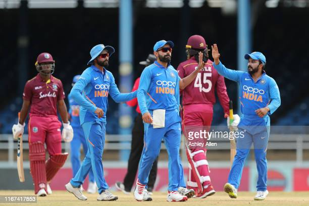 India pick up the wicket of Chris Gayle LBW to Bhuvneshwar Kumar for 11 during the second MyTeam11 ODI between the West Indies and India at the...