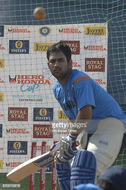 India player MS Dhoni bats during Indian team's practice session prior to the first ODI between India and Australia at Reliance Cricket Stadium...