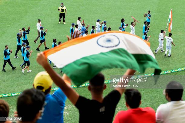 India players and staff parade around the ground during day five of the 4th Test Match in the series between Australia and India at The Gabba on...