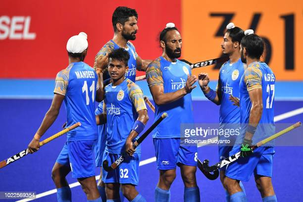 India players celebrate a point during Men's Hockey Pool A Preliminary Round match between Japan and India on day six of the Asian Games on August 24...