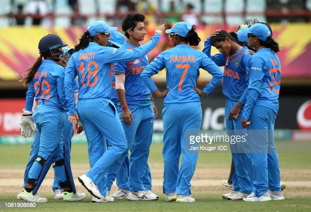 India players celebrate a wicket during the ICC Women's World T20 2018 match between India and Ireland at Guyana National Stadium on November 15 2018...