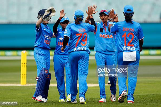 India players celebrate after taking the wicket of Jess Jonassen during the women's Twenty20 International match between Australia and India at...
