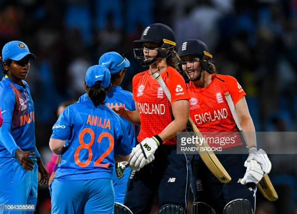India players congratulate Amy Jones and Nat Sciver of England for winning the ICC Women's World T20 2nd semifinal match between England and India at...