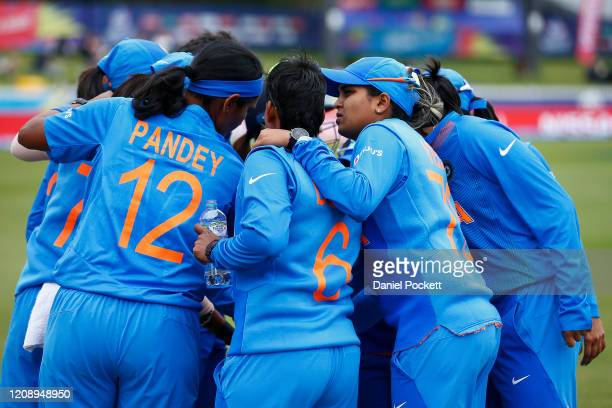 India players huddle during the ICC Women's T20 Cricket World Cup match between India and New Zealand at Junction Oval on February 27, 2020 in...