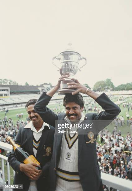India players Kapil Dev lifts the trophy as Man of the Match Mohinder Armanath looks on after the 1983 Prudential World Cup Final victory against...