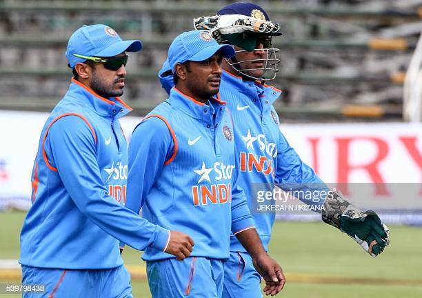 India players leave the pitch lead by captain Mahendra Singh Dhoni after dismissing Zimbabwe during the second One Day International cricket match...