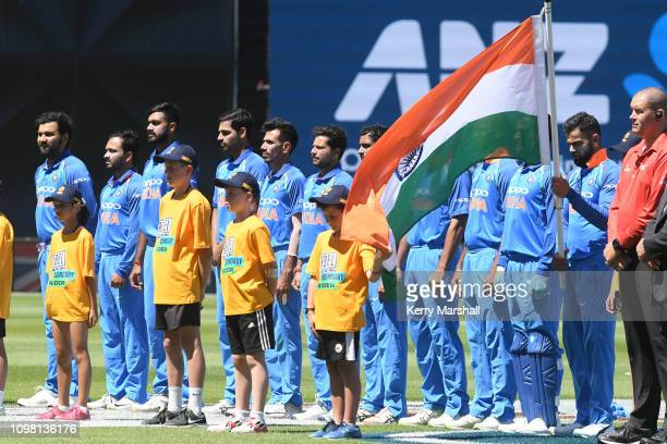 India players line up for their national anthem before game one of the One Day International series between New Zealand and India at McLean Park on...