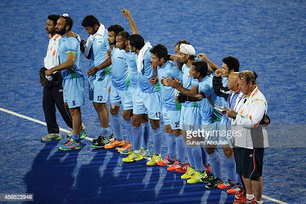 India players line up on the field during the penalty shootout in the men's hockey gold medal match on day thirteen of the 2014 Asian Games between...