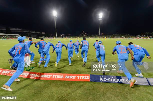 India players run onto the field in the moment the won the World Cup during the ICC U19 Cricket World Cup Final match between Australia and India at...
