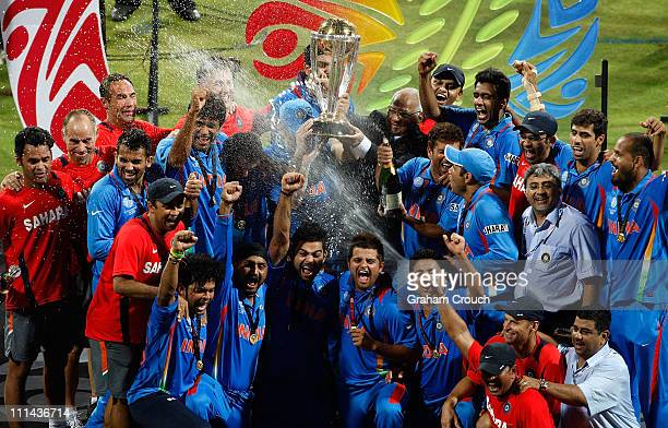 India players Yuvraj Singh Virat Kohli and Dr Nitin Patel celebrate with the trophy after India defeated Sri Lanka a in the 2011 ICC World Cup Final...