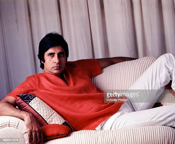 1987 India Portrait of Amitabh Bachchan sitting on sofa