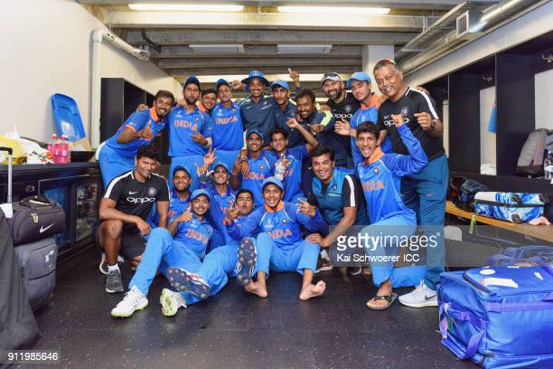 India pose for a team photo in the dressing room after their win in the ICC U19 Cricket World Cup Semi Final match between Pakistan and India at...