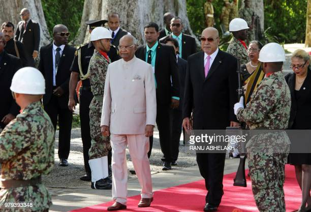 India President Ram Nath Kovind and Suriname President Desi Bouterse participate in a garland ceremony at the Baba Mai monument which represents the...