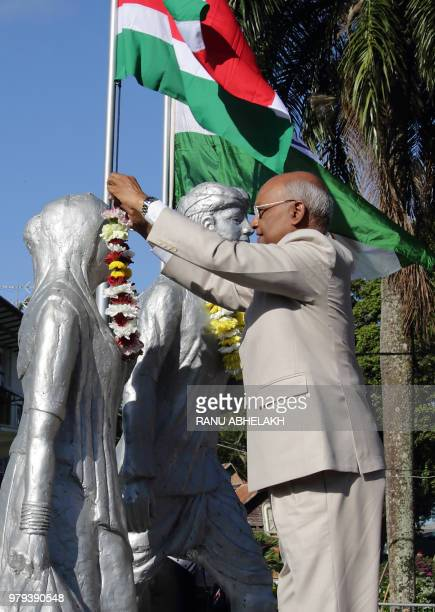 India President Ram Nath Kovind participates along with Suriname President Desi Bouterse in a garland ceremony at the Baba Mai monument which...