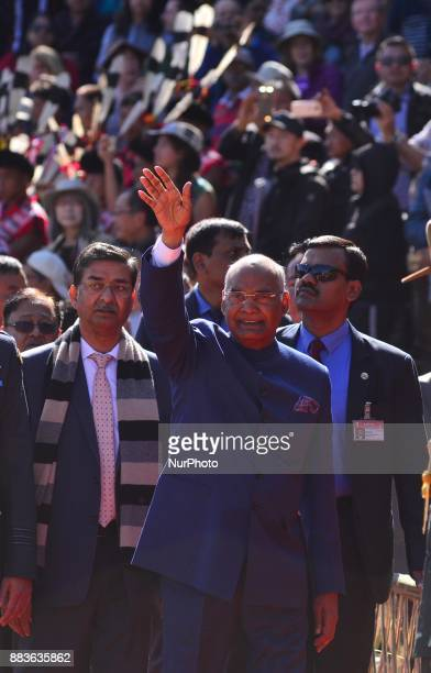 India President Ram Nath Kovind waves to crowd as he arrives to attain the opening ceremony of the Hornbill Festival at the Naga heritage village...
