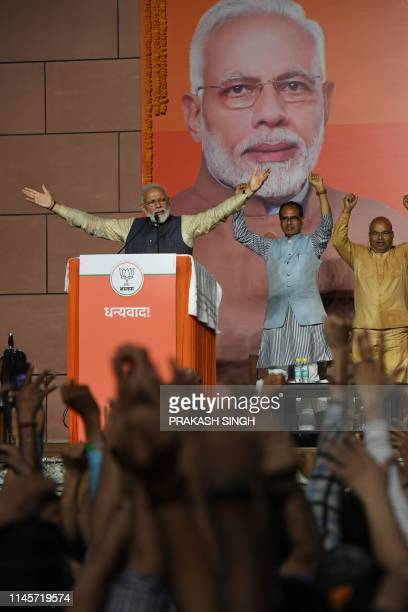 India Prime Minister Narendra Modi gestures on stage during his victory speech at the Bharatiya Janta Party headquarters after winning India's...