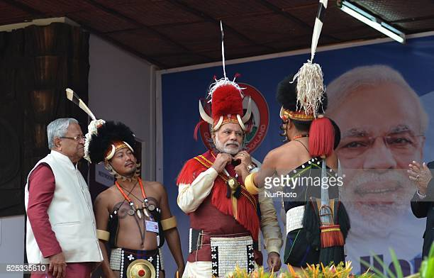 India Prime Minister Narendra Modi is presented with Naga traditional attires at the opening ceremony of the Hornbill Festival at Kisama some 15km...