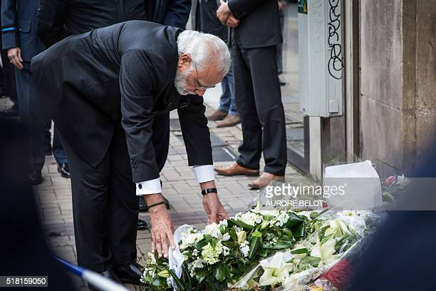 India Prime Minister Narendra Modi leaves a flower bouquet at the Maalbeek Maelbeek subway station in Brussels on March 30 2016 to pay a tribute to...
