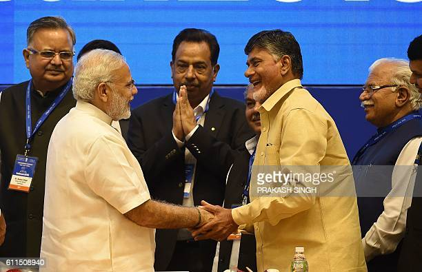 India Prime Minister Narendra Modi shakes hands with Chief Minister of Andhra Pradesh state Chandrababu Naidu as Chief Ministers of Chhattisgarh...