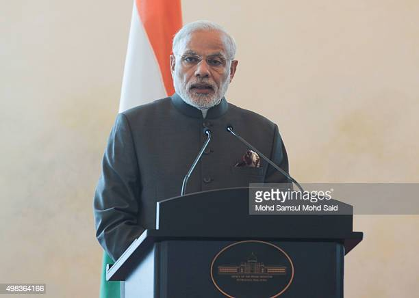 India Prime Minister Narendra Modi speak to media at news conference inside the Malaysia's Prime Minister office during an official visit to Malaysia...